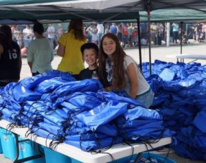 giving out school supplies